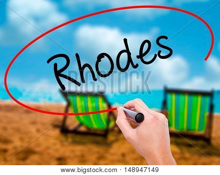 Man Hand Writing Rhodes With Black Marker On Visual Screen