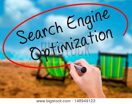Man Hand Writing Search Engine Optimization With Black Marker On Visual Screen