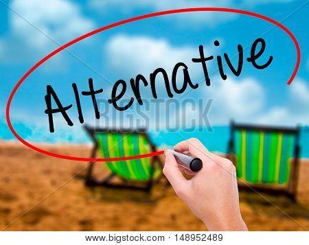 Man Hand Writing Alternative With Black Marker On Visual Screen.