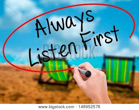 Man Hand Writing Always Listen First With Black Marker On Visual Screen