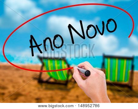 """Man Hand Writing """"ano Novo"""" (in Portuguese: New Year) With Black Marker On Visual Screen"""
