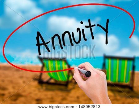Man Hand Writing Annuity With Black Marker On Visual Screen