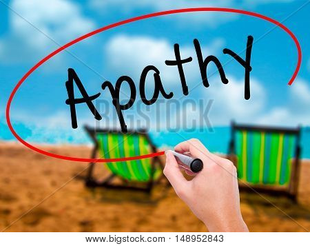 Man Hand Writing Apathy  With Black Marker On Visual Screen