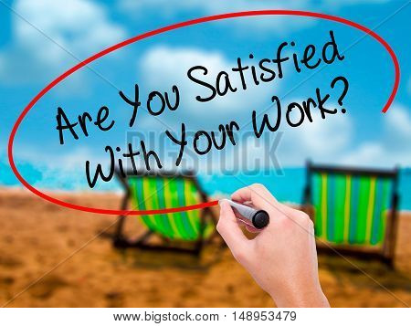 Man Hand Writing Are You Satisfied With Your Work? With Black Marker On Visual Screen