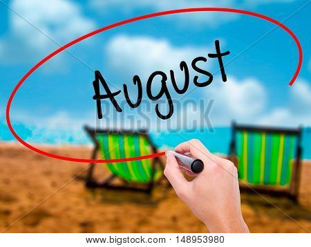 Man Hand Writing August  With Black Marker On Visual Screen