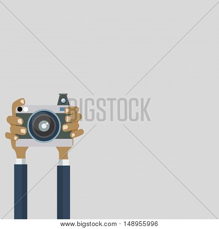 Flat illustration of photo camera with hand holding it. Vector illustration of a hand holding Vintage camera for your design