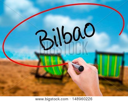 Man Hand Writing Bilbao  With Black Marker On Visual Screen