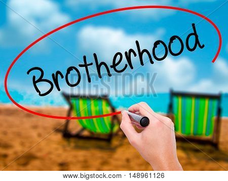 Man Hand Writing  Brotherhood  With Black Marker On Visual Screen