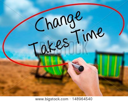 Man Hand Writing Change Takes Time With Black Marker On Visual Screen.