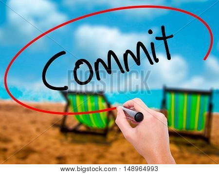 Man Hand Writing Commit With Black Marker On Visual Screen