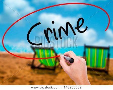 Man Hand Writing Crime With Black Marker On Visual Screen