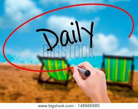 Man Hand Writing Daily With Black Marker On Visual Screen