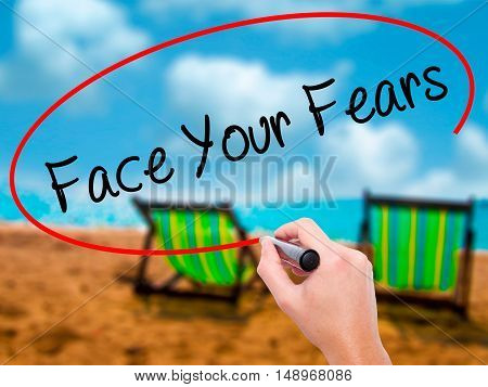 Man Hand Writing Face Your Fears With Black Marker On Visual Screen