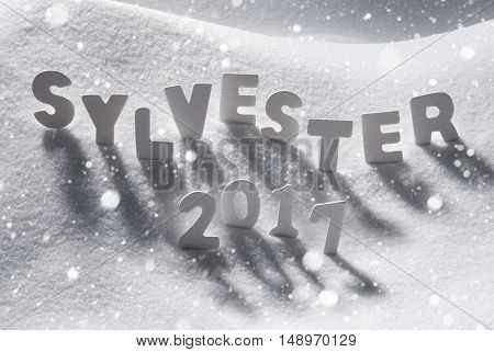 White Letters Building German Text Sylvester 2017 Means New Years Eve 2017 In Snow. Snowy Scenery With Snowflakes For Happy New Year Greetings.