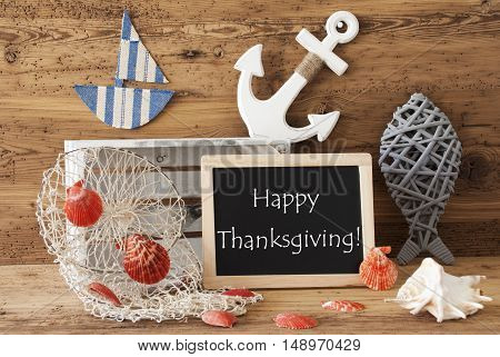 Blackboard With Nautical Summer Decoration And Wooden Background. English Text Happy Thanksgiving. Fish, Anchor, Shells And Fishnet For Maritime Contex.