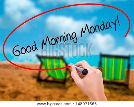 Man Hand Writing Good Morning Monday! With Black Marker On Visual Screen