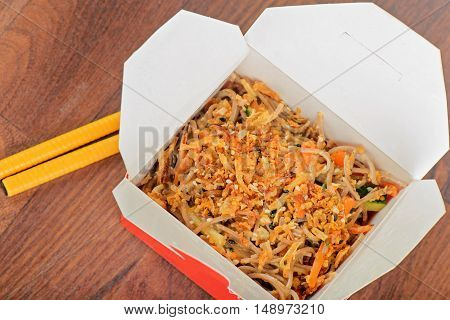Closeup of meat and noodles in take away container. Shallow depth of field.