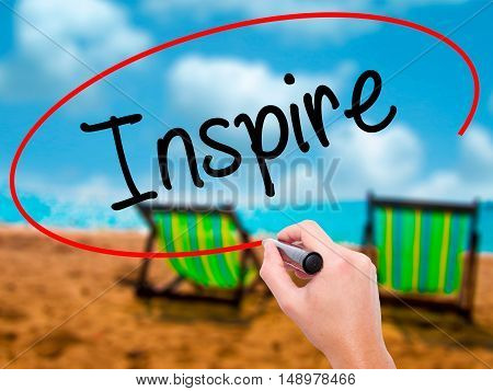 Man Hand Writing Inspire  With Black Marker On Visual Screen