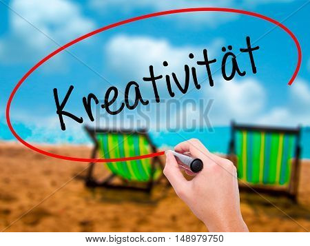 Man Hand Writing Kreativität (creativity In German)   With Black Marker On Visual Screen