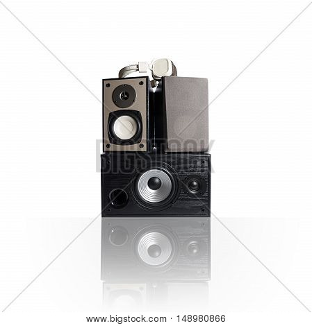 Image of three audio speakers in a wooden case and headphones. Photo isolated on white background with reflection on a horizontal surface. There is an empty seat for your text.