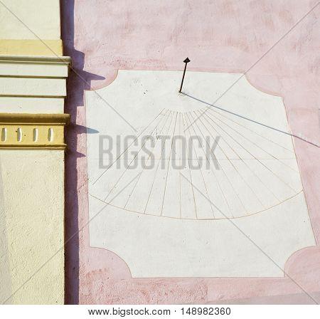 Sundial clock on the wall horizontal image