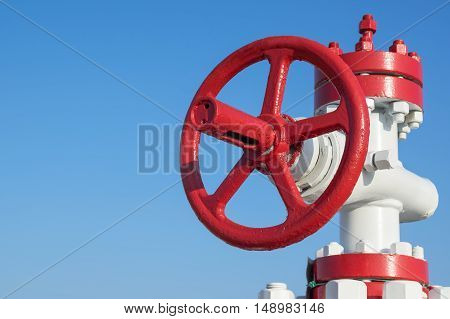 The gas control valve on background of blue sky