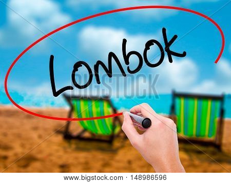 Man Hand Writing Lombok  With Black Marker On Visual Screen