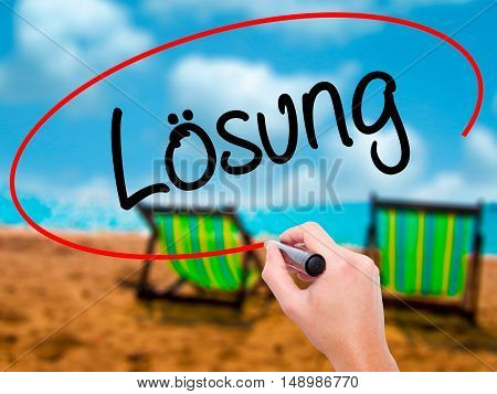 Man Hand Writing Losung (solution In German) With Black Marker On Visual Screen.