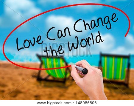 Man Hand Writing Love Can Change The World With Black Marker On Visual Screen
