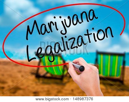 Man Hand Writing Marijuana Legalization With Black Marker On Visual Screen