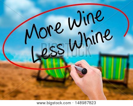 Man Hand Writing More Wine Less Whine With Black Marker On Visual Screen