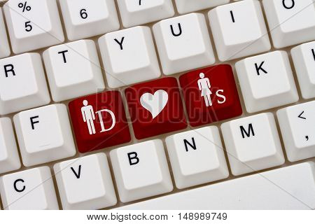 BDSM Internet Dating Sites A close-up of a keyboard with red highlighted symbol of man and two women and heart