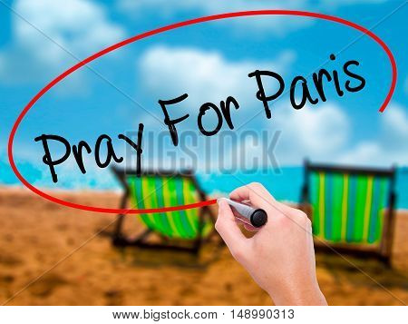 Man Hand Pray For Paris With Marker On Visual Screen
