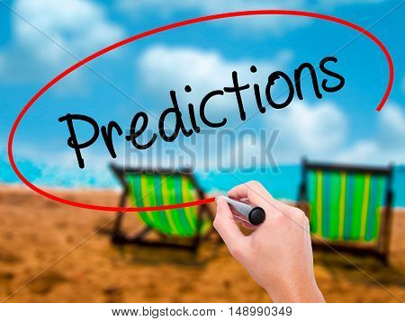 Man Hand Writing Predictions  With Black Marker On Visual Screen