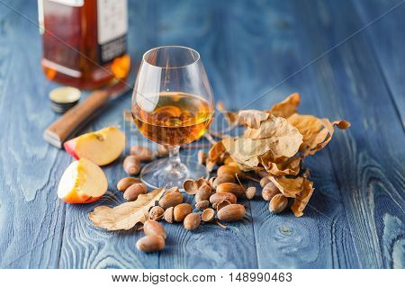 Snifter Glass With Amber Colored Brandy On A Grunge Wooden Table