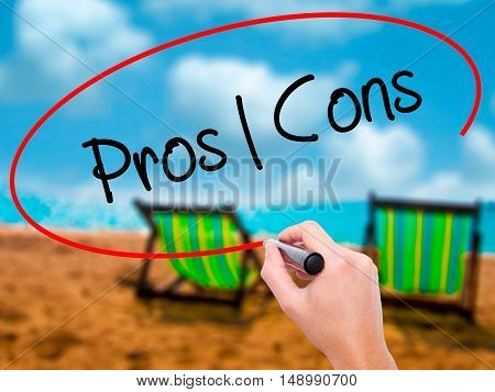 Man Hand Writing Pros  Cons With Black Marker On Visual Screen