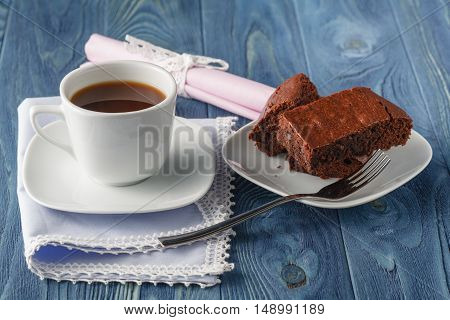 capuccino and chocolate brownie on blue table