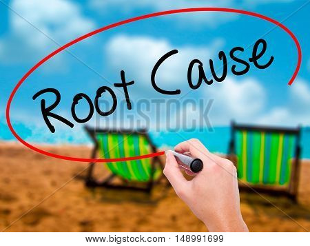 Man Hand Writing Root Cause  With Black Marker On Visual Screen