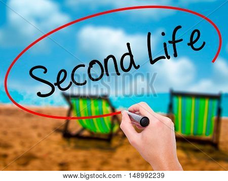 Man Hand Writing Second Life With Black Marker On Visual Screen.