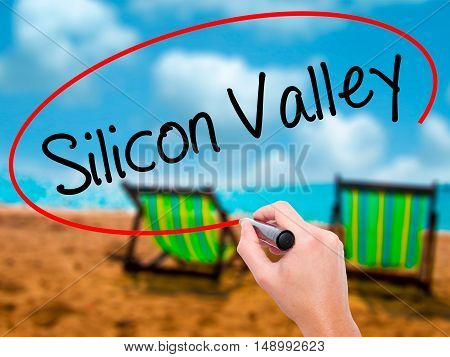 Man Hand Writing Silicon Valley With Black Marker On Visual Screen