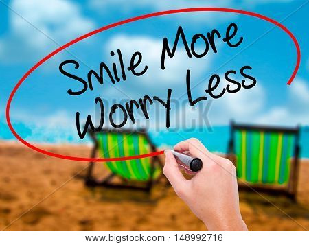 Man Hand Writing Smile More Worry Less With Black Marker On Visual Screen