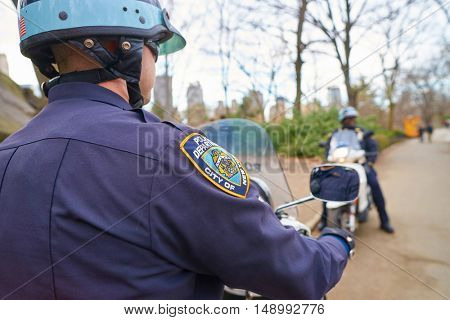 NEW YORK - CIRCA MARCH, 2016: NYPD sleeve patch shield on a police officer patrol in Central Park. The New York City Police Department is the largest municipal police force in the United States.