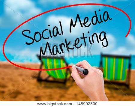 Man Hand Writing Social Media Marketing With Black Marker On Visual Screen