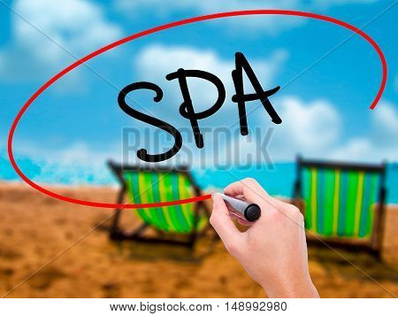 Man Hand Writing Spa With Black Marker On Visual Screen