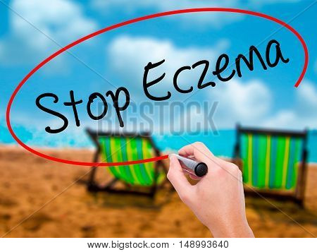 Man Hand Writing Stop Eczema With Black Marker On Visual Screen