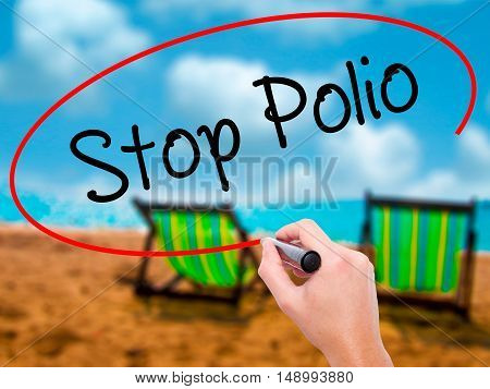 Man Hand Writing Stop Polio With Black Marker On Visual Screen