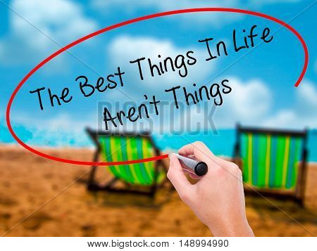 Man Hand Writing The Best Things In Life Aren't Things With Black Marker On Visual Screen
