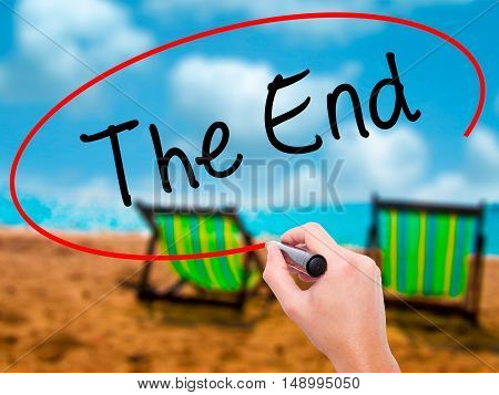 Man Hand Writing The End With Black Marker On Visual Screen