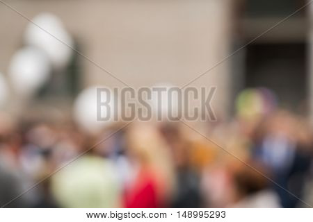 anonimous crowd of people outdoor on street, background blur