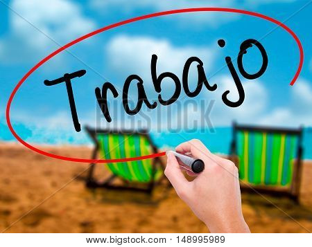 Man Hand Writing Trabajo  ( Work In Spanish) With Black Marker On Visual Screen